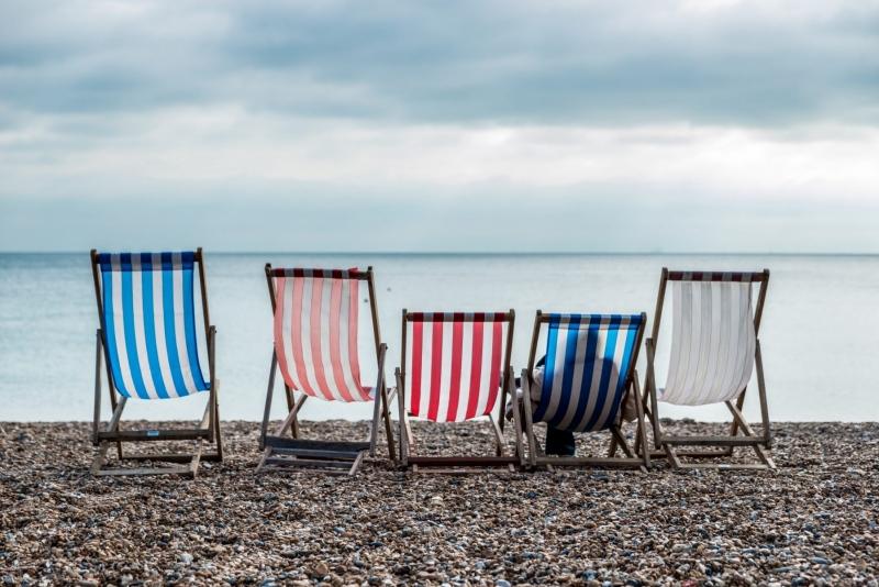 Beach chairs on a cloudy day in Brighton Beach, England.
