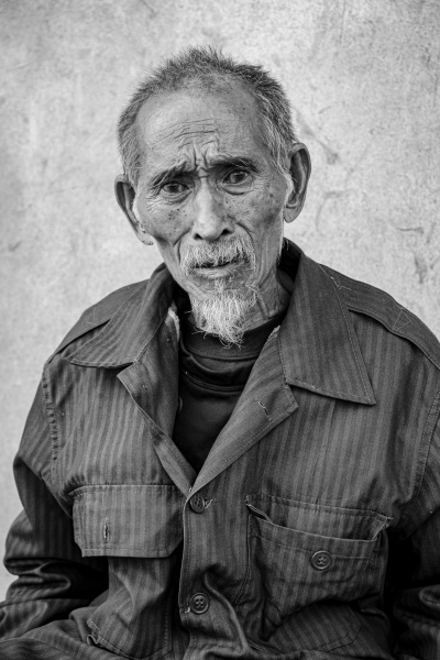 One of the oldest men in Ban Ano, and Akha village, near Muang La, Laos.