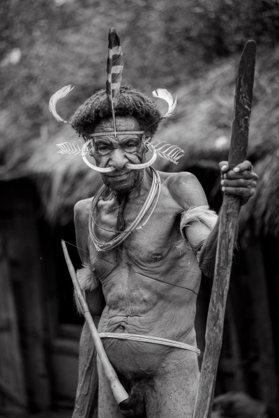 A Dani tribal elder, in tradition minimal dress, in Baliem Valley, Papua, Indonesia.