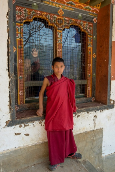 Novice monks, inside and out, in Punakha, Bhutan.