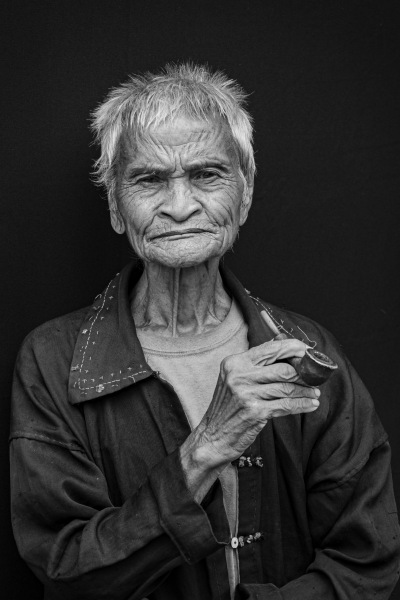 This pipe smoker, who claims to be 100 years old, lives in a village near Luang Namtha, Laos.