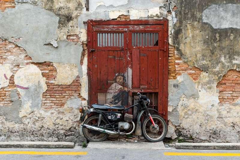 "A photo of a ""Boy on a Bike"" - public art in Penang, Malaysia."