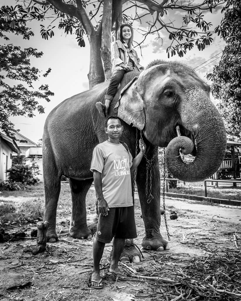 A photo of a mahout along with his daughter, who look after their pregnant 20 year old pet elephant.