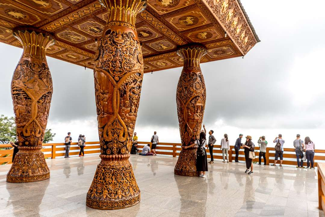 A photo of the detailed wooden columns at Doi Suthep temple, near Chiang Mai, Thailand.