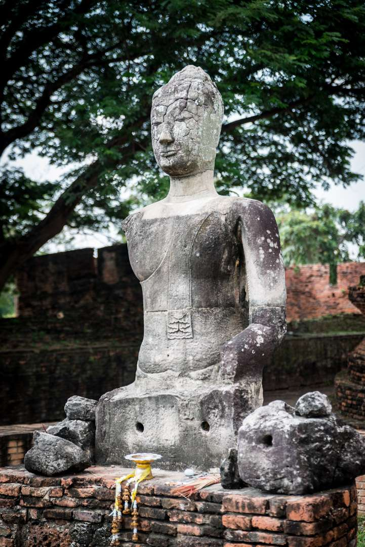 A photo of a partial Buddha statue, in Ayutthaya, Thailand.