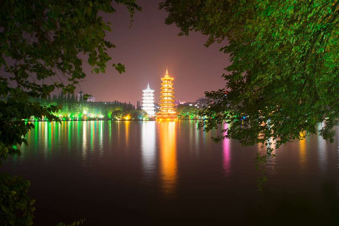 A photo of pagodas shot at night with a normal exposure.